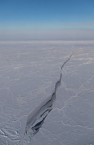 A partially refrozen sea ice lead  amongst ridged sea ice floes