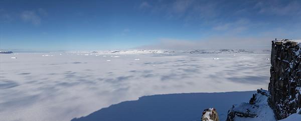 Kyle overlooking a sea ice & iceberg filled Wolstenholme Fjord