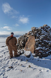 """Myself at the large cairn on top of Dundas, in my massive """"bear suit"""" coveralls"""