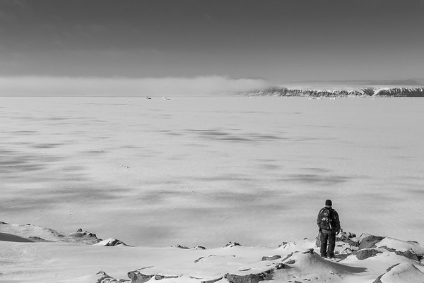 Kyle enjoying the view across a sea ice filled North Star Bay