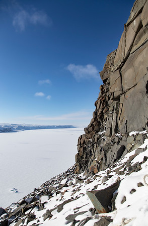 Up at the top of the slope, you encounter the sheer wall of the basalt top