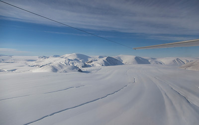 Looking down d'Ilberville Glacier, frozen meltwater channels on the surface