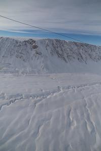 Frozen meltwater channels on lower Antoinette Glacier