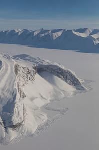 Tidewater cracks along the edge of sea ice below Glacier 259