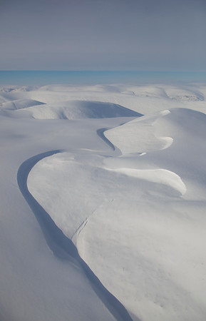 Wind-sculpted edges of a thick snow layer east of Agassiz Icecap