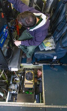 Alexey below the decks, coordinating with Matt during ATM repairs