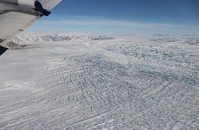 Crevasses spreading around a small peninsula on Zachariae Isstrom