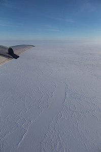 Multi-year floes and a refrozen lead, covered in snow, near the beginning of the line