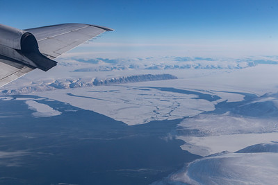 Just after takeoff we find the sea ice in Inglefield Fjord has broken off, likely due to this morning's high easterly winds