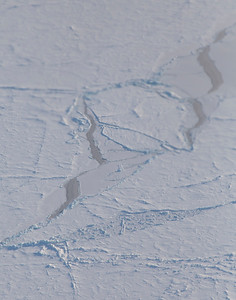 Mostly refrozen leads along a line of pressure ridges