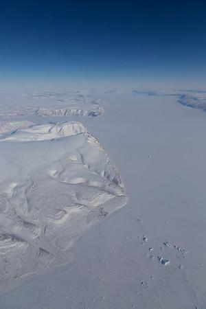 Qaanaaq and a sea ice covered Inglefield Fjord