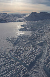 Crevasse-filled icebergs & sea ice along the terminus of Hagen Brae