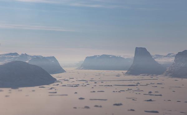 The mountain Ættestub rises over a fjord just west of Ryder Glacier