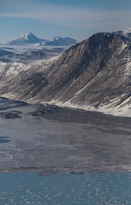 Mountains and frozen meltwater south of Zachariae Isstrom