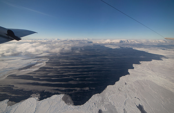 Sea ice leads full of grease ice windrows  in the Nares Strait; Ellesmere Island in the background as we climb out of the line