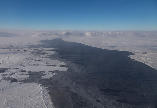 A sea ice lead full of grease ice in the Nares Strait, Ellesmere Island in the background