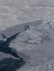 A lead and some finger-rafted snow free sea ice amongst older floes