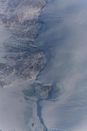Frozen melt pools along the northern edge of Hiawatha Glacier/crater