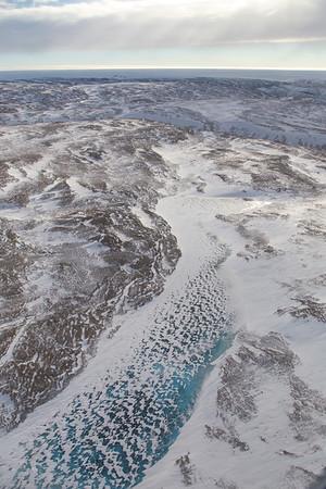 A frozen meltwater pond in Warming Land