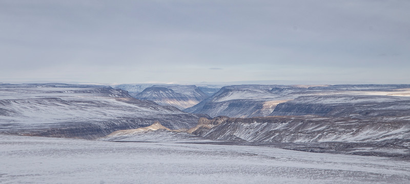 Looking out down distant canyons in Warming Land