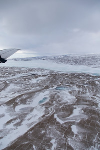 Frozen meltwater ponds, polygonal cracks and glacier ice in Nyboe Land