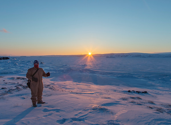 Me, all bundled up against the wind, with sea ice and a very beautiful sunset - a perfect evening!