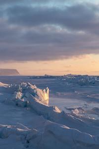 Coastal sea ice ridges and tidal pools along the shore