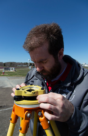 Craig levels the ground GPS antenna tripod for aircraft GPS antenna measurements