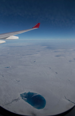 A large melt-pond on the surface of the ice sheet in western Greenland