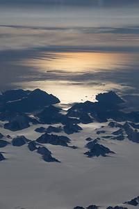 Nunataks, icebergs and the morning sun in east Greenland
