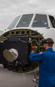 Aircraft Tech Matt works to unpack the Falcon after its ferry back to Kanger from the US
