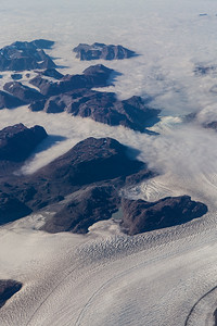 Clouds cover the lower portions of Qorkup Sermia