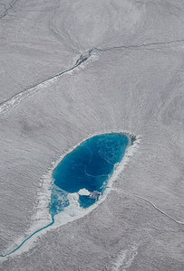 Another melt pond, actively draining on the surface of the ice sheet.