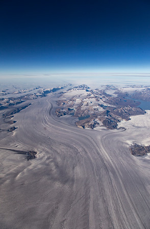 The upstream portion of Sermilik Glacier splits between terminating in a lake (right) and a fjord (left)