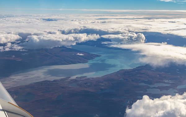 You can see the silt-laden outflow of the Qinnguata Kuussua (Watson River) meeting the waters of the Kangerlussuaq Fjord