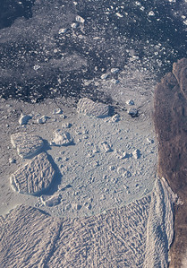 A close-up of the icebergs and calving front of Hayes Glacier