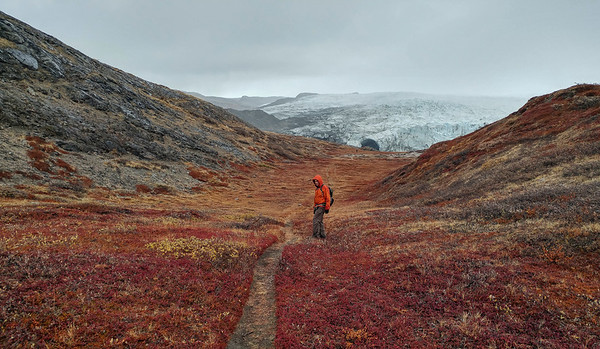 Serdar along the Russell Glacier trail with John in the distance