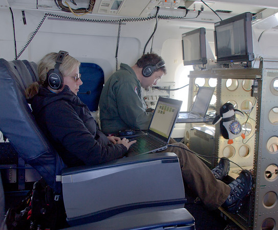 Christy (Project Manager) and Michael (Project Scientist), hard at work on the DC-8 over Thwaites Glacier