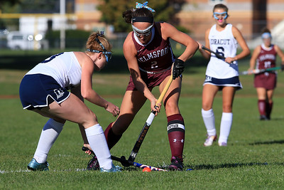 Dracut field hockey player Lily Jessico tries to stop Chelmsford's Steph Gilet during their match up on Monday afternoon. SUN/JOHN LOVE