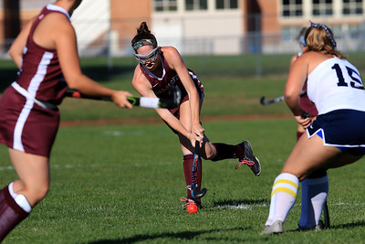 Chelmsford field hockey player Clare O'Neil takes a shot on goal during action in their game against Dracut on Monday afternoon. Trying to stop her is Dracuts Chloe Hudzick. SUN/JOHN LOVE