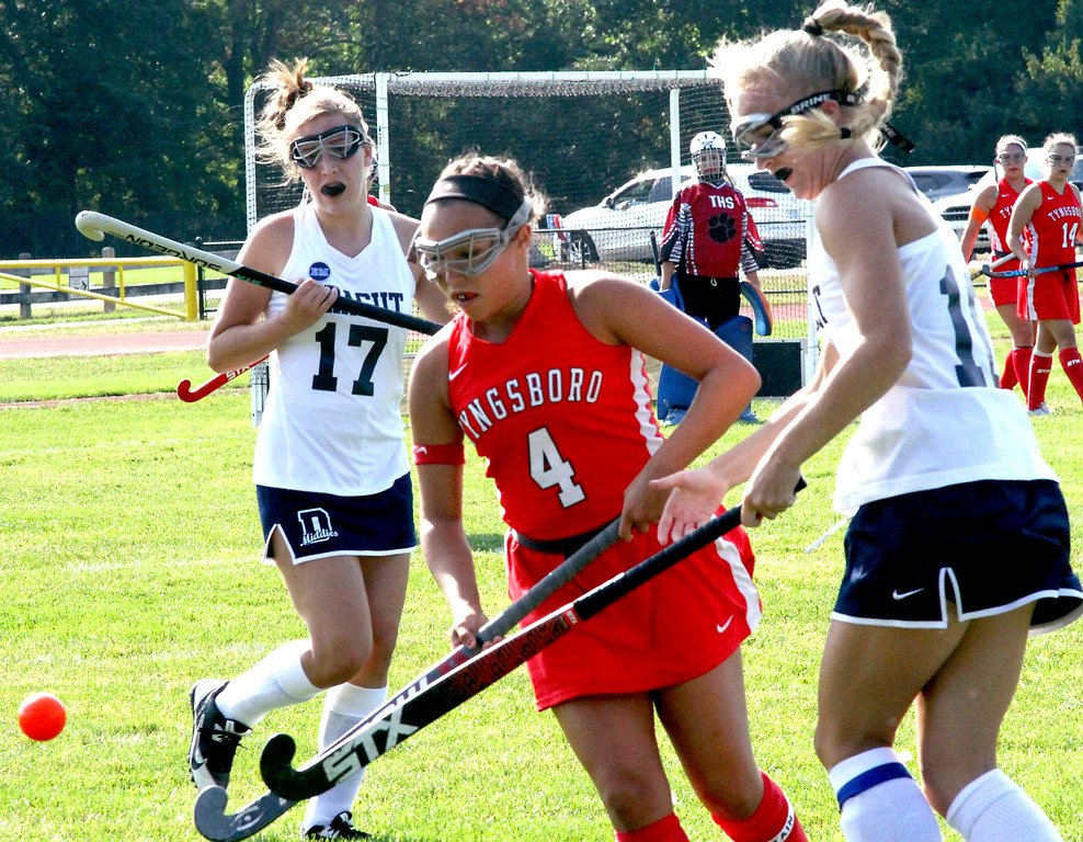 . Tyngsboro FH player #4-Angie Melanson, works the ball between Dracut players #17-Ava Pintal and #10-Sarah Wilson during the varsity game played at Dracut HS. SUN Photo by David H. Brow