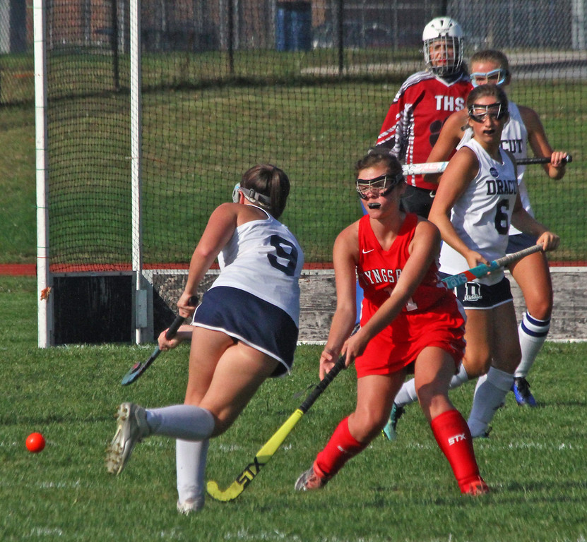 . Dracut FH player #9-Becca Maille passes off to another player as she runs into Tyngsboro players. SUN Photo by David H. Brow
