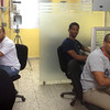 ONAMET personnel in their site monitoring room. Names from left to right : Roldan Avila, Edgar Ulerio, and Javier Acosta. (Photo/Mike Fend, UNAVCO)