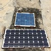 Solar panels at JME2, on the roof of the police headquarters in the town of Jacmel in southern Haiti. Station maintenance in July 2016. (Photo/Mike Fend, UNAVCO)