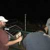 Brett Carpenter, University of Oklahoma (OU), and Jefferson Chang and Isaac Woelfel, Oklahoma Geological Survey (OGS), work on finishing OK05 after dark with headlight and flashlight assistance. (Photo/Keith Williams, UNAVCO)