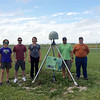 """Prof. Julie Elliott and her class helped replace an antenna that was not tracking L2 due to a bad LNA at EarthScope Plate Boundary GPS Station P775 located at Purdue University. Elliot coordinated with UNAVCO field engineer Summer Miller to make the trip a """"teachable moment."""" Thanks to these five students, and the grasshopper mascot hanging out on top of the dome! August 2016. (Photo/Julie Elliot, Purdue University)"""