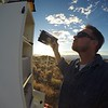 """UNAVCO field engineer Adam Woolace upgrades EarthScope Plate Boundary Observatory GPS station P391 to a Septentrio PolaRx5 GNSS receiver. More on P391 near McDermitt, Oregon: <a href=""""http://www.unavco.org/instrumentation/networks/status/pbo/overview/P391"""">http://www.unavco.org/instrumentation/networks/status/pbo/overview/P391</a> (Photo/Adam Woolace, UNAVCO)"""