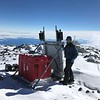 UNAVCO field engineer Thomas Nylen works on a GPS station on Nausea Knob, a rock outcrop on the upper slopes of Mount Erebus named for the many workers who experienced altitude sickness at the site - it sits at 3633 m or just under 12,000 feet above sealevel. January 4, 2018. (Photo/Annie Zaino, UNAVCO)