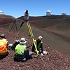 Graduate student Nathan Stephenson, undergraduate student Margaux Mellott and Office of Mauna Kea Management (OMKM) researcher Amber Stillman participate in a scan from one cinder cone to the next in order to image the landscape and a handful of observatories. (Photo/Marianne Okal, UNAVCO)