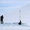 Dan Bradford collects GPS data of the snow surface and sample site locations while UNAVCO engineer Brendan Hodge holds the survey antenna. Repeat measurements of snow surface height will help to constrain the snow accumulation rates on the glacier. (Photo/Tim Godaire, U. Maine)
